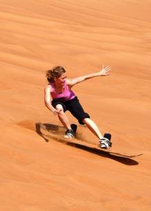 Sandboarding Utah at Little Sahara - Utah's Best Vacation Rentals